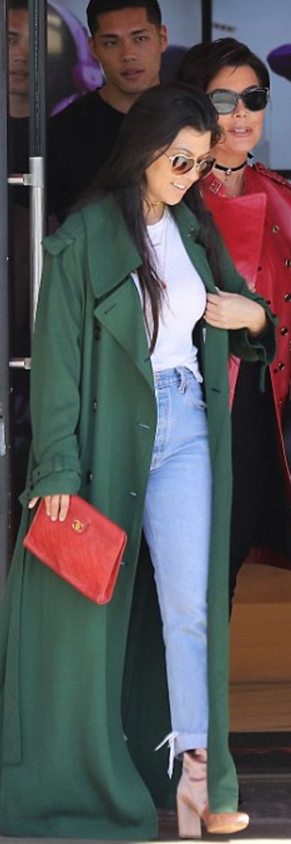 Who made Kourtney Kardashian's green trench coat, tan satin ankle boots, and red clutch handbag?