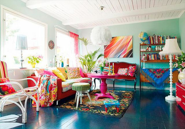 so fun! love how colorful and bright it is ... i WANT that pink table ...