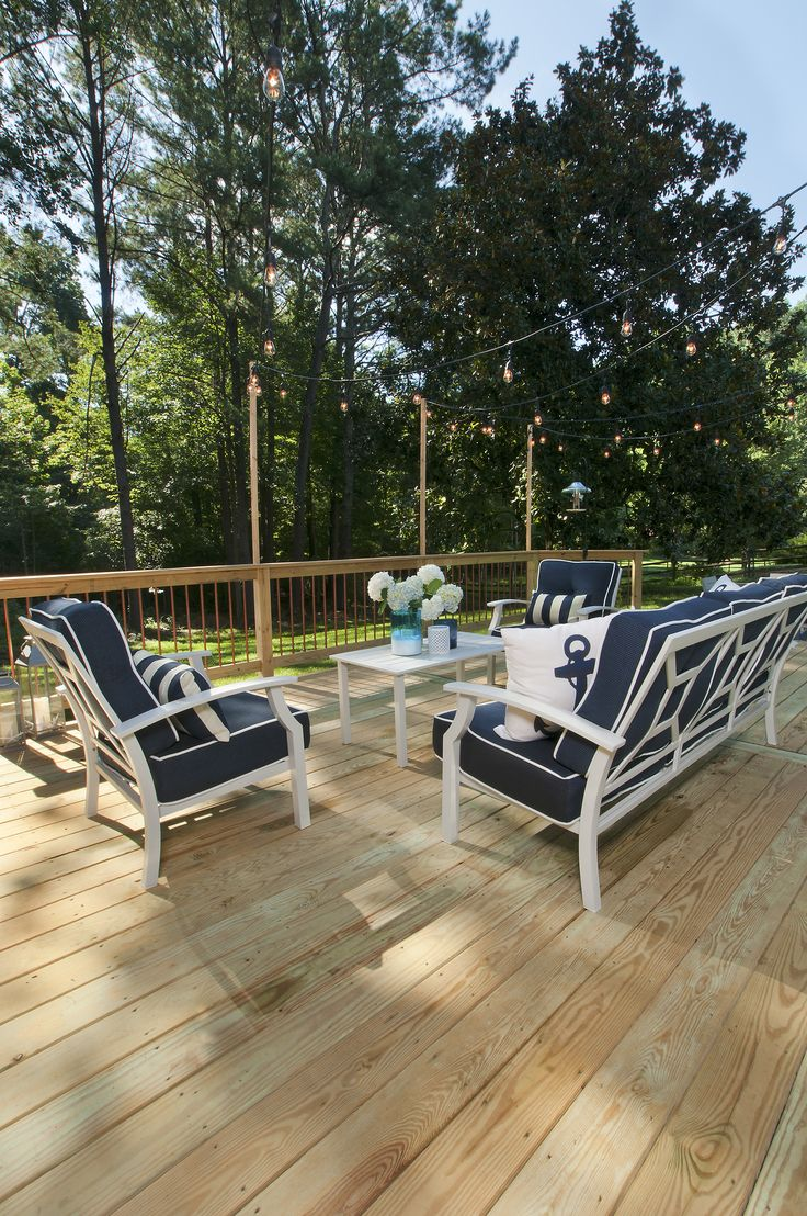 Pressure treated deck with simple poles for evening lighting. Designed and built by Atlanta Decking.