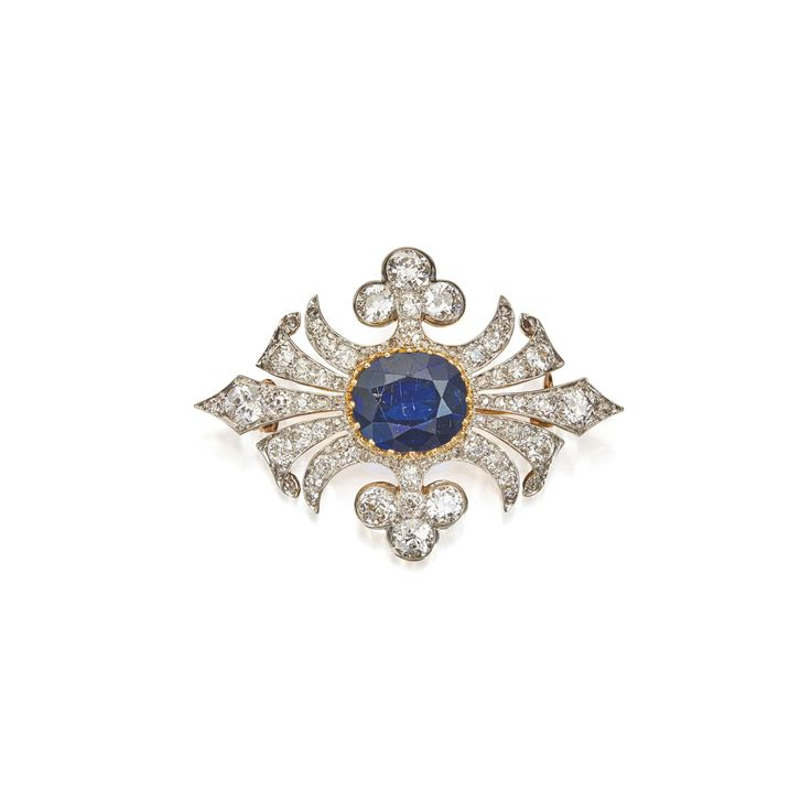 Platinum, Gold, Sapphire and Diamond Brooch. Centering an oval-shaped sapphire, set with old European, old mine, and single-cut diamonds.