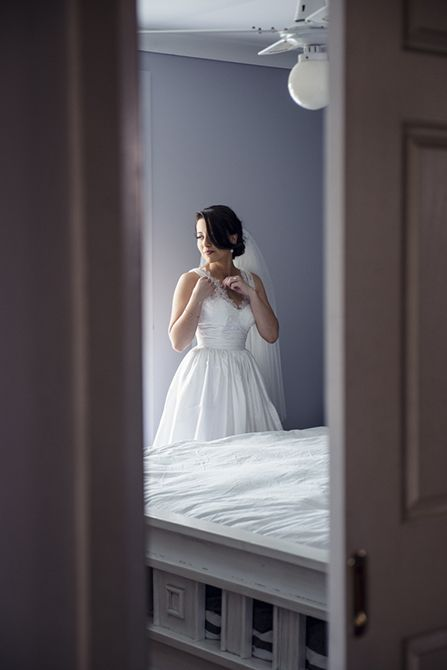 I love this peak through the doorway shot of our bride #markjayphotography #sydneyweddingphotographer #weddingphotography #bride #weddingdress #pose