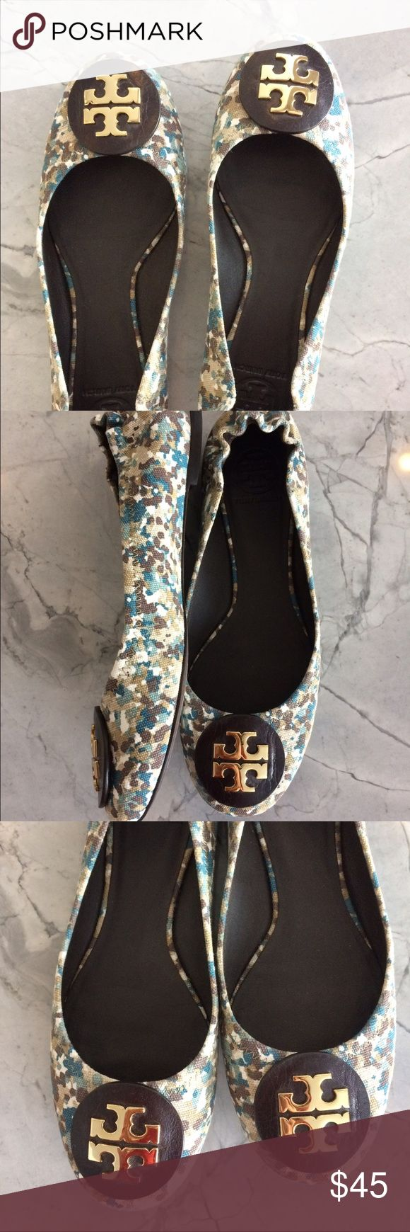 Tory Burch Flats fabric/leather Super cute Tory Burch fabric flats. The silver decal sits atop a brown leather circle. I bought these at the Nord rack last year. They are perfect for fall. Tory Burch Shoes Flats & Loafers
