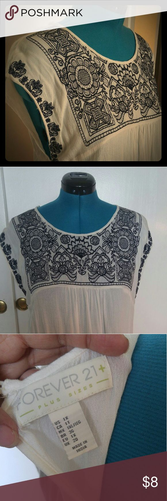 Forever 21 Plus - Boho Tunic Gently used white tunic top with navy blue embroidery - perfectly ligbt for those hot summer days and nights!  Its small enough as a Size 12 ! Forever 21 Tops Tunics