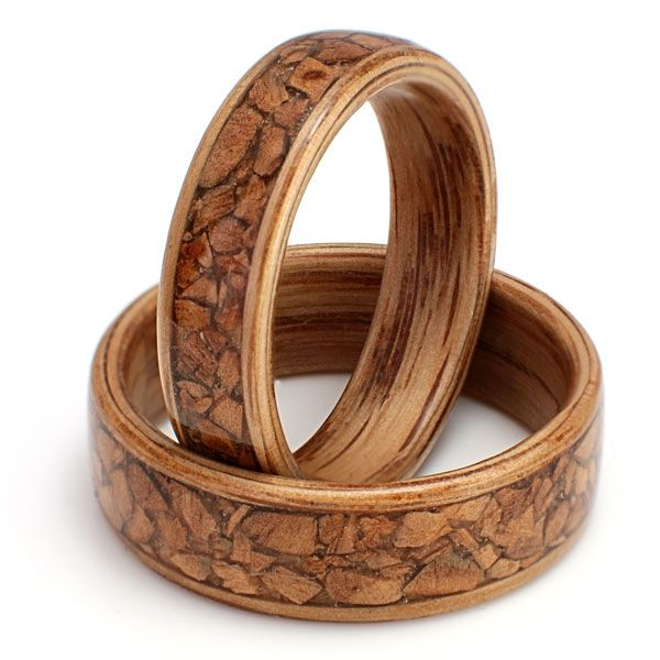 Eco Wood Rings. Custom Design Rings. Oak set with broken olive wood ring pieces inlaid.