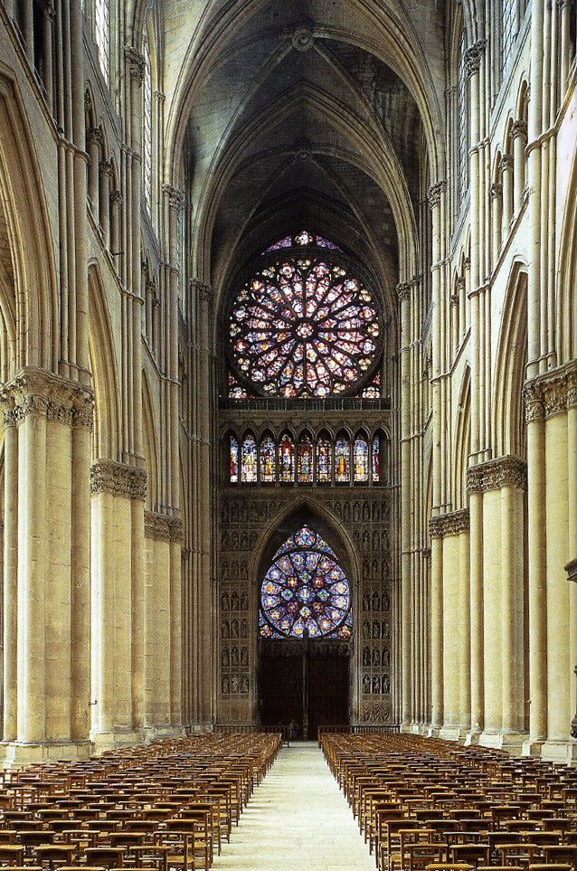 LATER FRENCH GOTHIC: Nave of Reims Cathedral, 1211-1290. View facing the entrance. Notable for the double rose windows and the height of the nave.