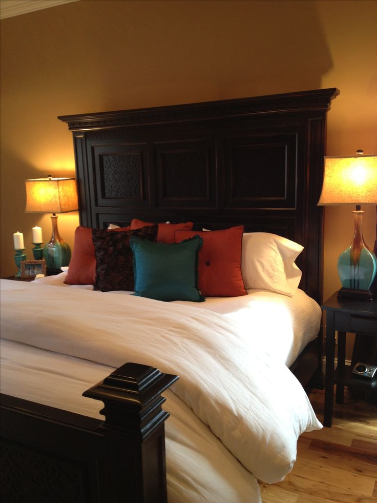 White bedding with brown burnt orange and turquoise for Burnt orange bedroom ideas