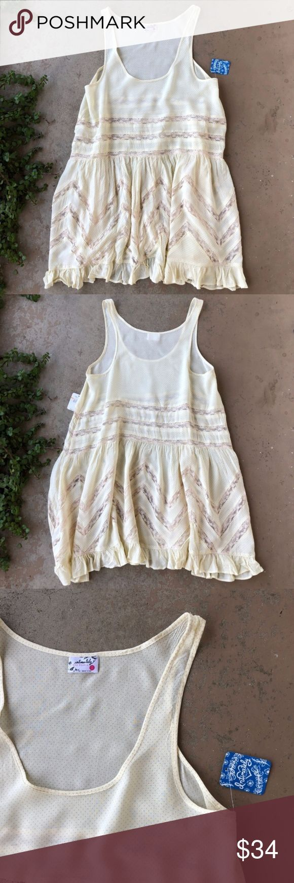 Free People Yellow Polka Dot Trapeze Slip Dress Intimately Free People pale yellow polka dot asymmetrical lace slip trapeze dress. Size small, new with tags! Free People Dresses Mini