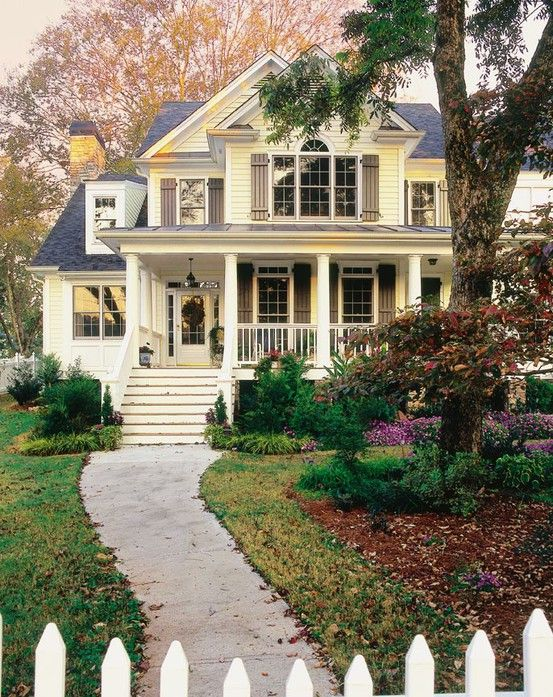 oh my gosh! i want a white picket fence, yellow house with a wrap around porch with flowers and a green lawn. this is pretty damn close!!!