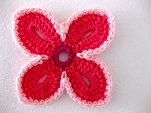 crochet Hawaiian flowers. It's kinda complicated and is a UK version, and mine turned out floppy, but they look so cool!