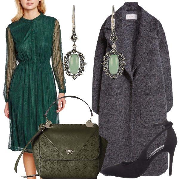 Verde lush meadow è il color Pantone che va molto di moda. E di questa tonalità di verde è l'abito che vediamo qui, con collo alla coreana, in pizzo, con abbottonatura anteriore e maniche semitrasparenti. Abbiniamo un cappotto grigio, dal taglio classico, in lana, scarpe nere, con tacco alto e sottile, borsa a tracolla, color verde oliva e orecchini in argento con incastonate pietre di giada e marcassite.