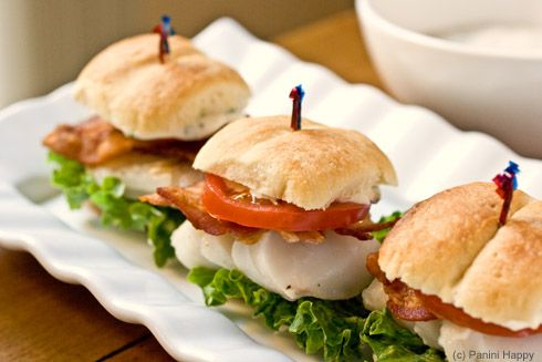 Grilled Cod Sliders with bacon, lettuce, tomato and homemade dill tartar sauce on Parker House Rolls