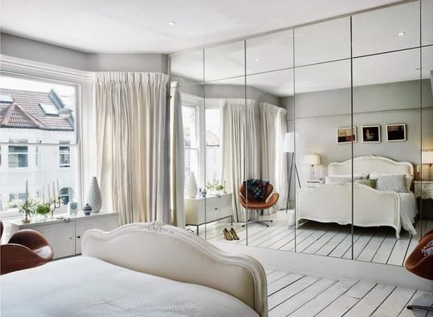 Instead of a solid wide mirrored wall, this is divided into sections. Nice treatment or mirrors.