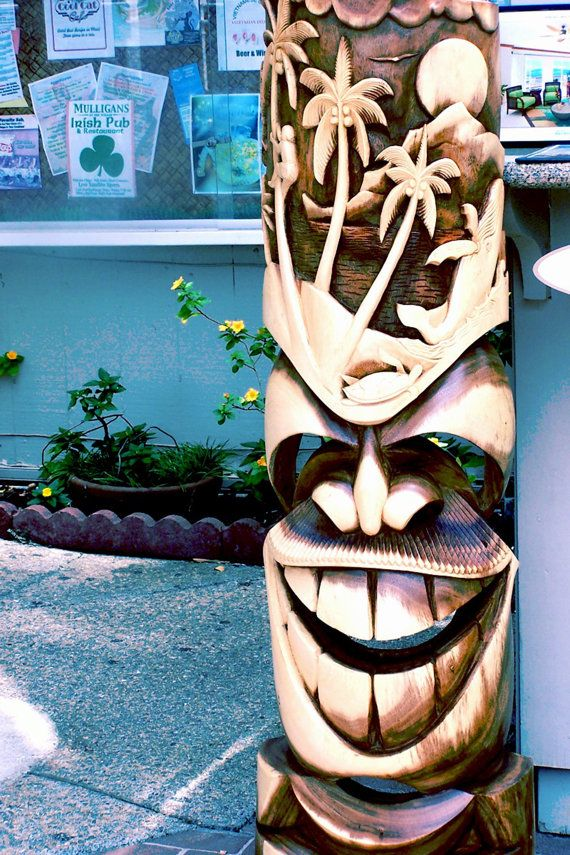 tiki carvings in Old Lahaina Ok- WOW! This is a pic of another tiki by the same carver that did ours.