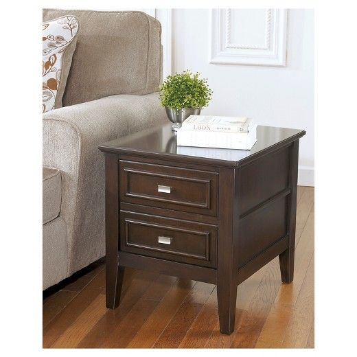 With the Larimer end table you get a beautifully clean-lined and contemporary piece that doesn't skimp on function. Roomy drawers keep essentials out of sight and the tabletop clear of clutter. An elegant finish allows the rich veneer grain to shine through.  Signature Design by Ashley is a registered trademark of Ashley Furniture Industries, Inc.