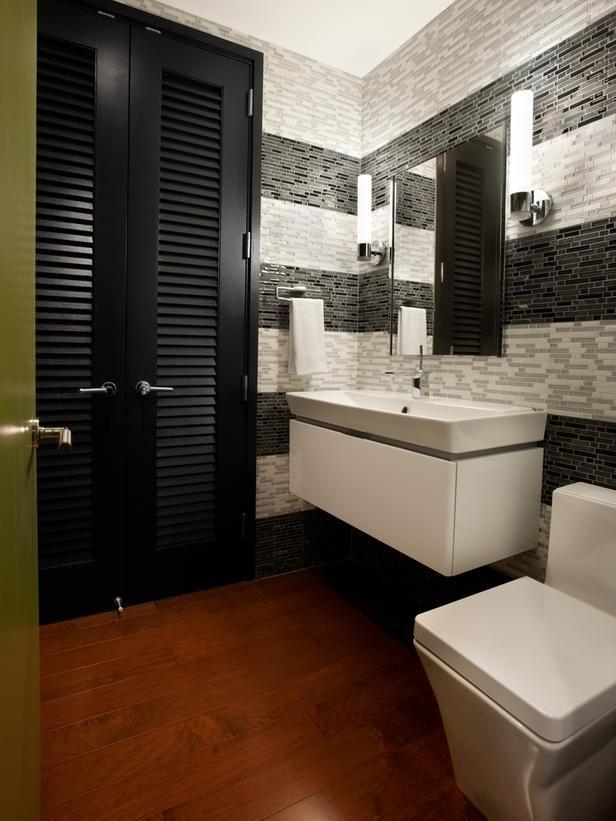 Urban bathroom with floating sink. The striped tile back splash adds dimension.