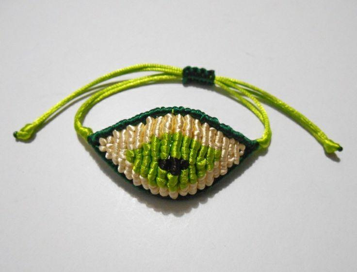 green/beige/light green evil eye