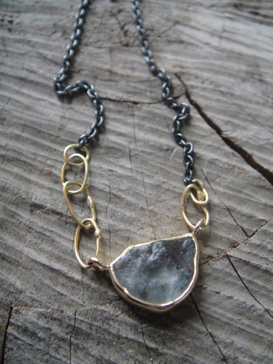montana sapphire necklace by sarah mcguire. I love the irregularity, mixed metals, and organic loops.