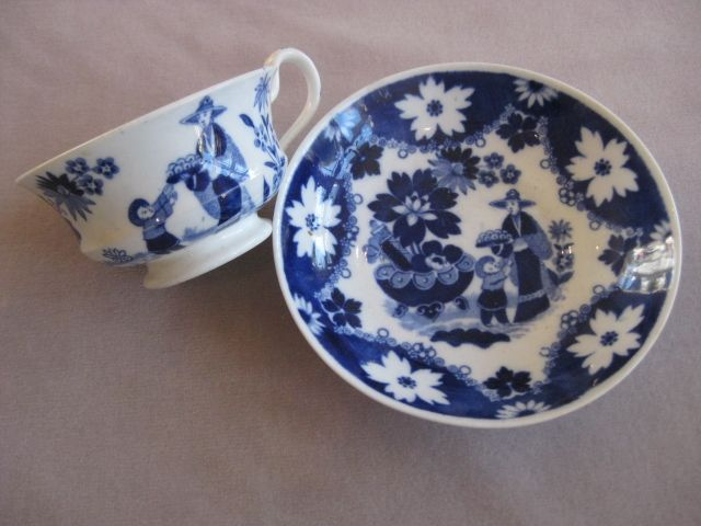 """A Hilditch porcelain cup and saucer decorated with the """"Eskimo Child"""" pattern in blue. Wreath & Crown mark Circa 1825"""