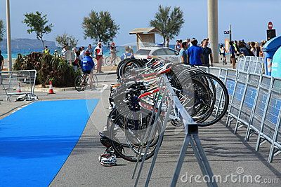 The participant's bikes of children's sports competitions on a steel rack. Playa de Palma. Mallorca, Spain