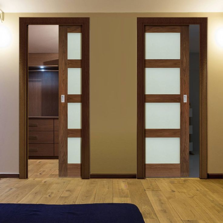 Deanta Unilateral Pocket Coventry Walnut Prefinished Shaker Style Door with Frosted Glass.    #pocketdoors  #unilateraldoors  #moderninterior  #interiordesign  #doors