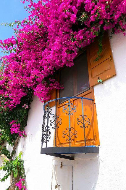 Pretty balcony with pink bougainvillae. Megalo Chorio. Tilos island, Dodecanese, Greece