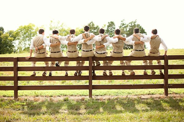 Southern wedding - all the guys sitting on a fence