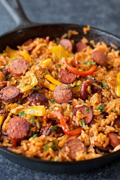Smoky kielbasa sizzled with sweet bell pepper, onions and garlic in vibrant tomato sauce. This quick and easy sausage, pepper and rice skillet is downright delicious!