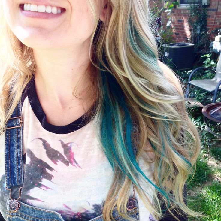 Long blonde wavy blue teal green peekaboo hair style