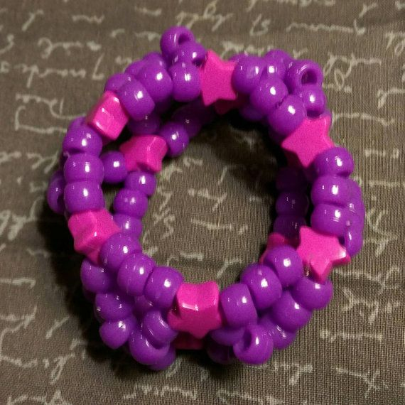 Check out this item in my Etsy shop https://www.etsy.com/listing/261531693/puffy-x-base-kandi-cuff-pink-star-beads