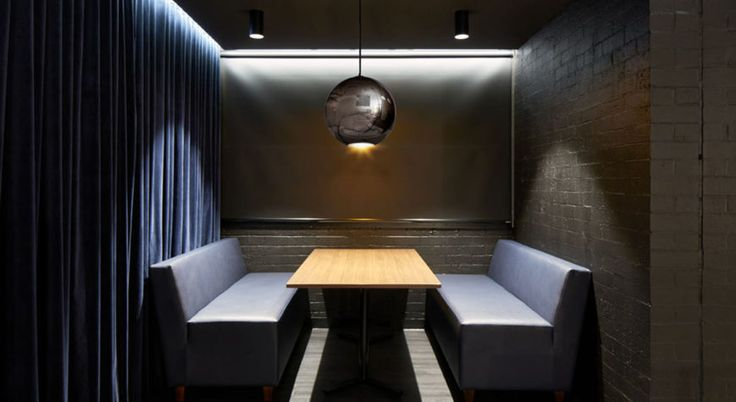 The Eagle Bar Private Dining Room at La Trobe University. Bundoora designed by Studio 103 beautifully features Atelier Oxford velvet as curtaining, creating a moody and luxurious setting.  Product used: Atelier Oxford