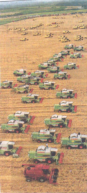 white combines | Tractors, Plows, and Harvesters of the Past