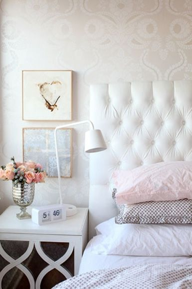 Tufted headboard, dreamy white and touches of rosy pink in a bedroom!