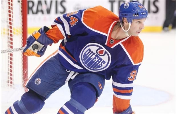 Ryan Smyth of the Edmonton Oilers makes a play against the Dallas Stars during a NHL showcase pre-season game at the Cox Convention Center i...