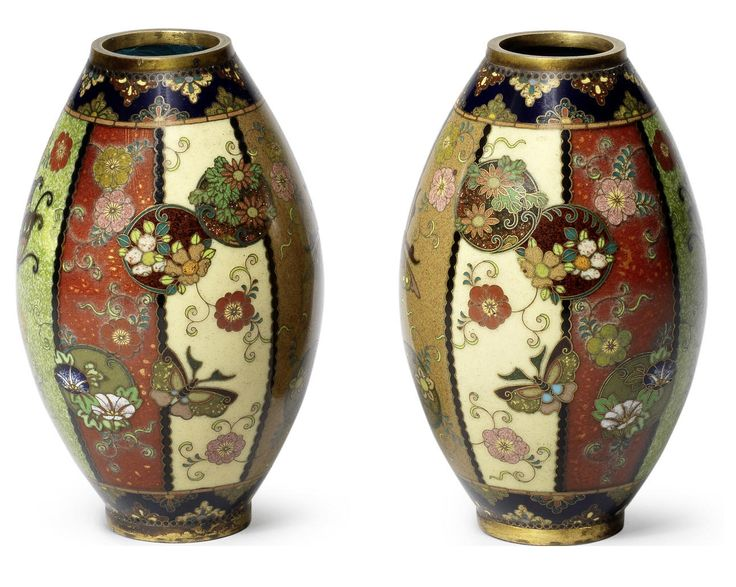 A pair of small ovoid cloisonné enamel vases by Namikawa Yasuyuki, Meiji Period Both worked in silver and gilt wire and decorated with a matching design, the body with eight tapering panels of differently-coloured grounds of yellow, coffee brown, speckled green and semi-transparent red, scattered with overlapping foliate and floral roundels, stylised butterflies and foliate scrolls, the neck and foot with formal patterns on a midnight-blue ground, applied with gilt-metal mounts