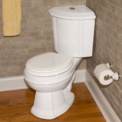 Corner toilet. Perfect for a tiny powder room or for making room for a bigger tub!