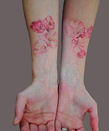 http://tattoomagz.com/pastel-tattoos/beautiful-pastel-pink-blossoms-tattoo/