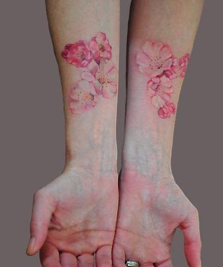 http://tattoomagz.com/pastel-tattoos/beautiful-pastel-pink-blossoms-tattoo/