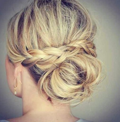 This is good idea. I'm just guessing how   this was done. She put braids on each side behind the ear, then overlapped   braids, and secured with hair pins underneath. Make a bun on the bottom. Hair   spray all over. Will try it sometime to see if my guess is   correct.