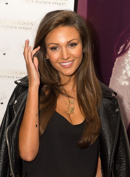 Michelle Keegan medium brown hair tanned summer skin