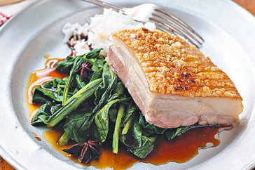 Slow-roasted pork belly on asian greens