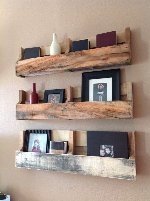 This listing is for a set of 3 reclaimed wood pallet shelfs. Each shelf will have its own unique weather patterns. We only use discarded pallets to create a beautiful rustic shelf. Each one measures Length 40 inches Width/depth 3.5 inches Height -approx 10 inches Convo us for pricing on single shelfs or painted shelfs.
