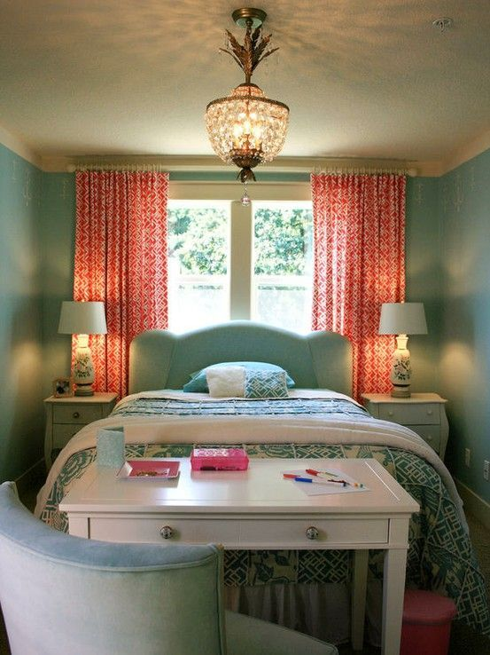 Lots of great ideas about what to do with windows behind the bed. Love the simple headboard with bright panel curtains.