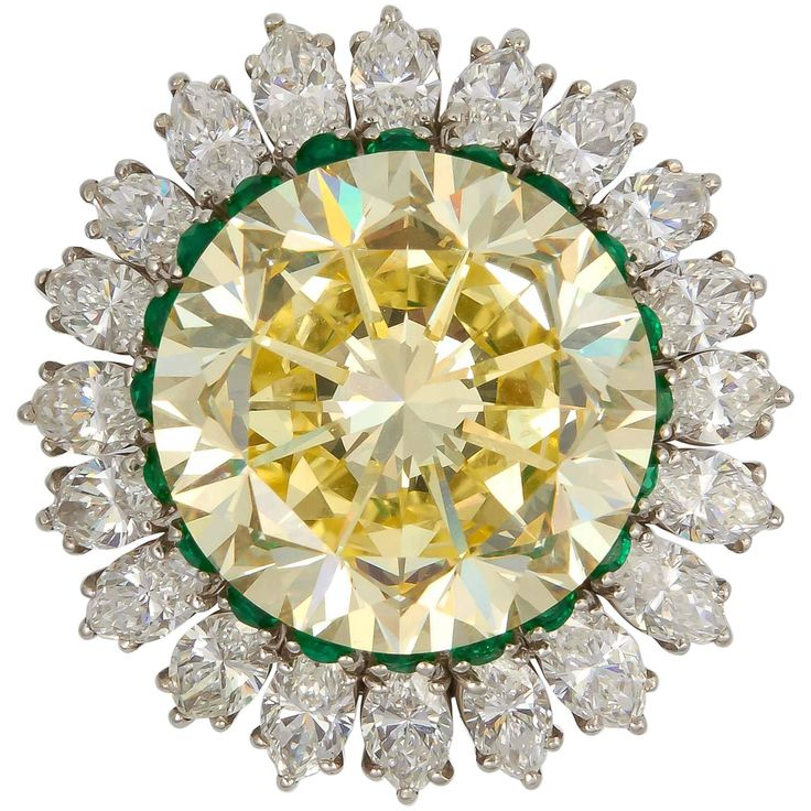 Fancy Intense 22.77 Carat Yellow Diamond Platinum Ring | From a unique collection of vintage cocktail rings at https://www.1stdibs.com/jewelry/rings/cocktail-rings/