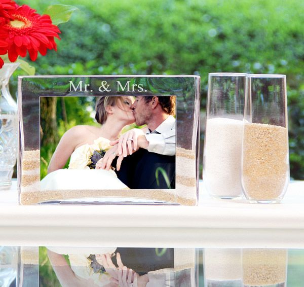 The Mr. & Mrs. Sand Ceremony Photo Vase Unity Set is a beautiful alternative to the traditional unity candle. Use it to symbolize the blending of your two lives together. Set includes a large, custom engraved photo vase and two side pouring vases.