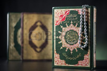 Islamic Books of Holy Quran on Soft Light Background