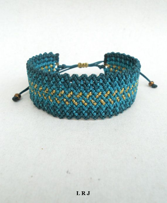 This handmade macrame bracelet is made out of emerald,petrol and gold waxed string. It is water resistant because waxed string is very durable in water. It is adjustable and has a sliding knot closure in order to fit a lot of sizes. Custom orders for different color combinations are welcome. Width: 2.2cm / 0.87 inches Similar zig zag bracelets from my shop: https://www.etsy.com/listing/183628818/rainbow-ombre-zig-zag-macrame-cuff?ref=related-2…