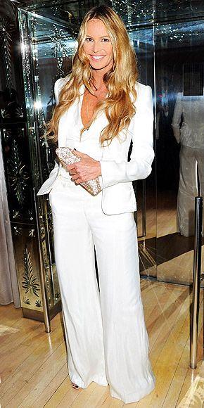 Elle MacPhearson channeling Cheryl Ladd in a retro white pantsuit