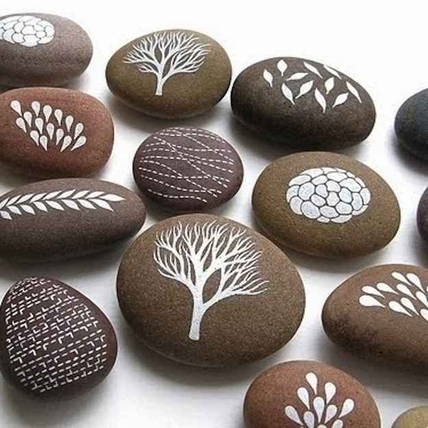 Nature-Painted Rocks. Cute idea to spice up a shelf or end table. Or maybe keep in the freezer then use as fancy ice cubes for guests?