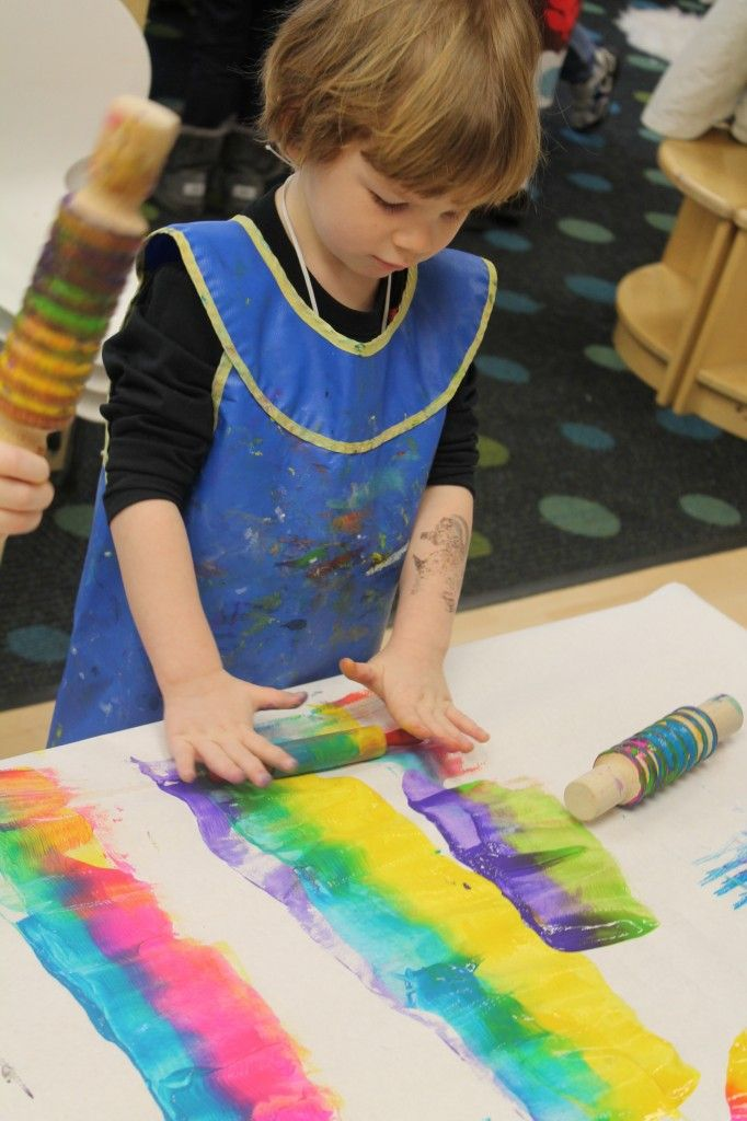 Exploring color theory through hands on art- Mixing Paint with Rolling Pins- add rubber bands or bubble wrap to the rolling pins for even more fun!
