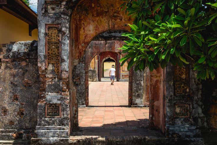 Through the archway - Man walking in the sun at Hue Royal Palace.